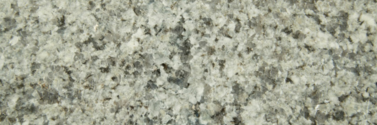 <strong>SKU 1020 Azul Platino</strong>: Granite. Tight speckled with a gloss finish. Grey color.