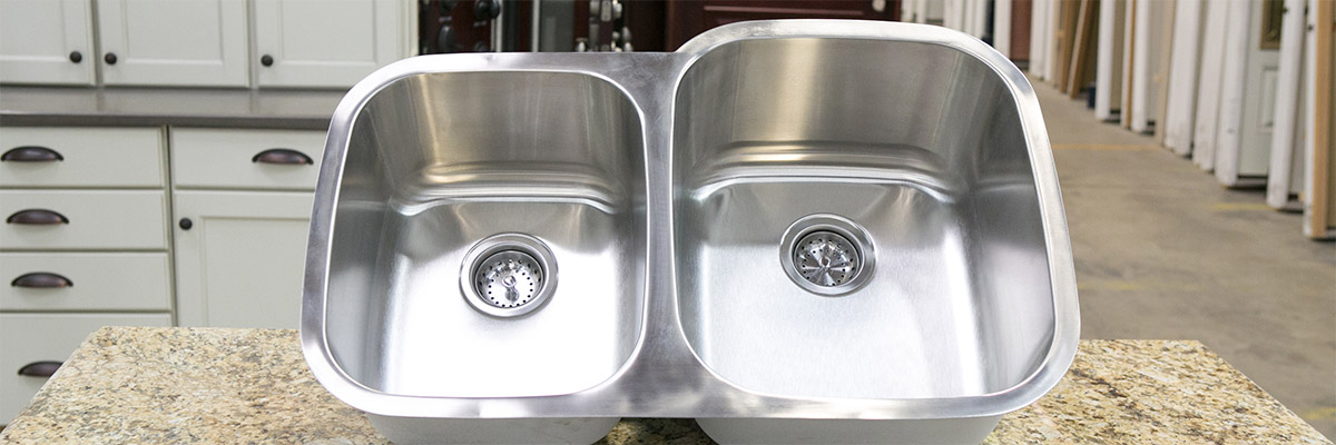 <strong>SKU 1711</strong>: Stainless undermout sink with offset bowl. We like this style as it has a more custom look.